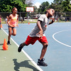 John P. Cleary | The Herald Bulletin<br /> Kids participating in the Parks Department's summer youth program runs laps around the basketball court to warmup before they start going through basketball fundamental drills.