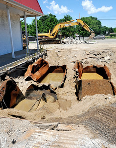 John P. Cleary | The Herald Bulletin Work began Monday on the removal of underground storage tanks and contaminated soil from the site of a former gas station at 2691 Nichol Ave.