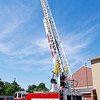 Mark Maynard | For The Herald Bulletin<br /> As one of their first challenges, new Alexandria Fire Department recruits are required to climb to the top of Elwood Fire Deparment's 100 foot high snorkle truck while wearing an air pack.