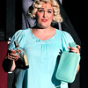John P. Cleary | The Herald Bulletin<br /> Sugar Kane (Melissa Franklin) hides her booze in a water bottle to not get caught drinking by band leader Sweet Sue.