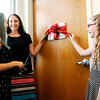 Don Knight | The Herald Bulletin<br /> With help from her mother Jennifer, left, and friend Kiley Huff, Sara Woolum prepares to cut the ribbon on a closet named in her honor at Community's Sexual Assault Treatment Center on Friday.