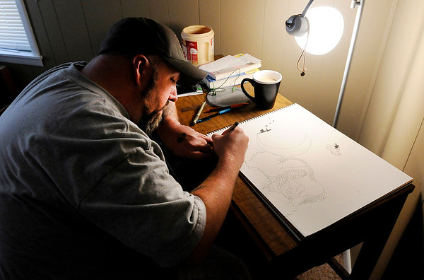 Don Knight | The Herald Bulletin<br /> Billy Riggs works on a drawing in his room at Exodus House. Community Hospital is offering to match donations up to $5,000 in a summer fundraiser for the Exodus House.