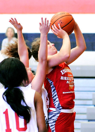 John P. Cleary    The Herald Bulletin <br /> Alexandria's Blaine Kelly goes up for a shot during the Junior Girls All-Star game Friday at AU.