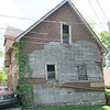 Don Knight | For The Herald Bulletin<br /> A historic carriage house in downtown Anderson is leaning to the east while the west wall is caving in. The building has been has been deemed unsafe by the Anderson Municipal Development Department.