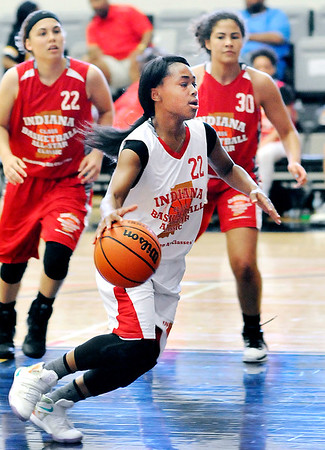 John P. Cleary    The Herald Bulletin <br /> Anderson's Anteria Hammond drives the lane during action in the Junior All-Star game Friday. Hammond was named the Mental Attitude Award winner for her team.