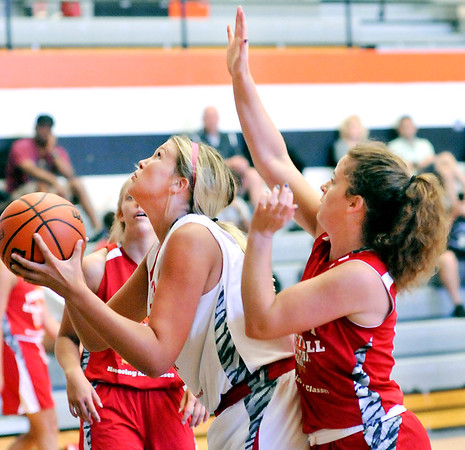 John P. Cleary |  The Herald Bulletin <br /> Lapel's Breanna Boles goes up for a shot as Alexandria's Blaine Kelly tries to defend from behind during the Junior Girls All-Star game Friday at AU.