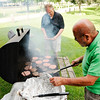 Don Knight | For The Herald Bulletin<br /> City Councilmen Bob Stinson, right, and Jeff Bryan work the grill during the 3rd annual Picnic in the Park hosted by the Alexandria Monroe Chamber of Commerce and the Madison County Community Health Center in Alexandria on Thursday.
