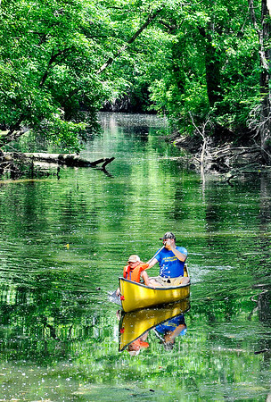 John P. Cleary |  The Herald Bulletin<br /> Douglas Eiler and his daughter Calaya Eiler, 7, paddle through the channel of Shadyside Lake Monday. Calaya was enjoying her first day of summer vacation from school by taking her first canoe ride with her dad.