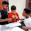 Don Knight | For The Herald Bulletin<br /> From left, Akai Hardy, Noeh Johnson and Markel Wright build their Skate Wheels design while working on a Transportation of the Future project at Highland on Wednesday.