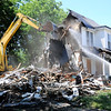 Don Knight | For The Herald Bulletin<br /> A crew with RHINO Enterprises demolishes the home at 13th and Jackson on Tuesday. This is the 21st blighted building this year to be taken down according to the city's Facebook page.