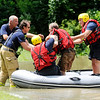 Don Knight | The Herald Bulletin<br /> AFD personnel help a man to shore after pulling him from Killbuck Creek during a water rescue on Killbuck Creek by DNR and AFD on Saturday.