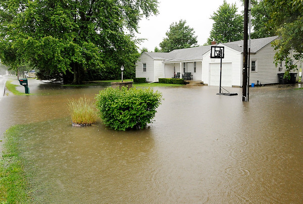 Don Knight | The Herald Bulletin<br /> Several homes along County Road 200 South had standing water on their property after heavy rain on Friday.