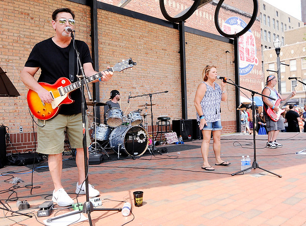 Don Knight | The Herald Bulletin<br /> The Str8-Shooters band performs downtown during Anderson On Tap on Saturday.