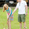 Don Knight | For The Herald Bulletin<br /> Dr. Drew Gleitsmann gives Alexandra Perry, 9, some instruction in how to play croquet during the Picnic in the Park hosted by the Alexandria Monroe Chamber of Commerce and the Madison County Community Health Center in Alexandria on Thursday.