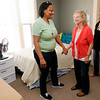 Don Knight | The Herald Bulletin<br /> Gloria Woods, left, talks to volunteer Marilyn Branham, center, at the House of Shifra as Elysia Carr, right, looks on.