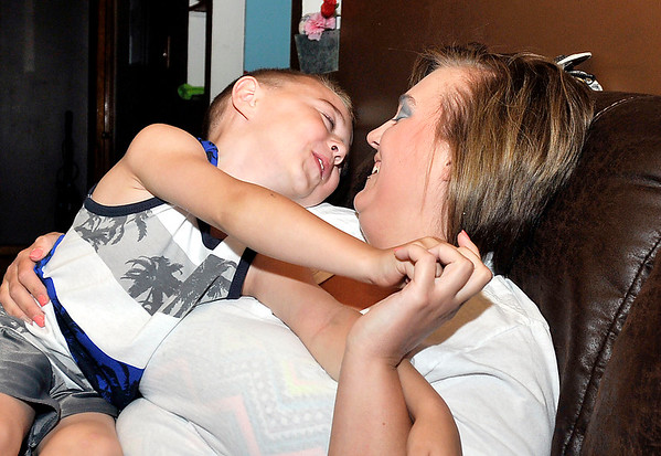 John P. Cleary    The Herald Bulletin<br /> Natasha McAdams and her son Bentley Chesnut, 5, have fun together at home after Bentley was shot in the head with a high-powered air rifle several weeks ago.