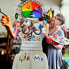 John P. Cleary |  The Herald Bulletin<br /> Connie Rector, owner of Gaia Herbals & Wholistic Center, checks out Abstract Annie, a sculpture the Pendleton Artists Society created, that is on display in Rector's business in downtown Pendleton.