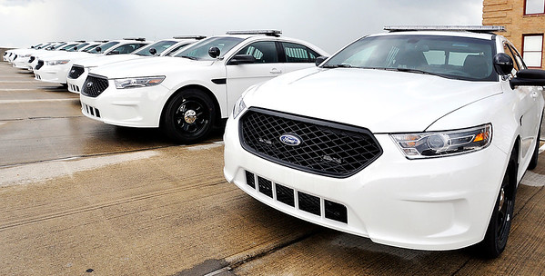 John P. Cleary |  The Herald Bulletin<br /> The Anderson Police Department is preparing these 20 new Ford Interceptor vehicles for service within the next two weeks. The all white patrol cars were being detailed this week.