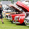 Don Knight   For The Herald Bulletin<br /> Steve Bower looks at a restored 1967 Nova SS owned by Larry and Jackie Corn during the 30th annual Bank Robbery Run and John Dillinger Car Show in Daleville on Saturday.