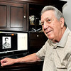 John P. Cleary |  The Herald Bulletin<br /> Ray Turner pauses as he looks over some of the old photos of his cousin Merrill Eugene Janney Jr. who was involved in D-Day.