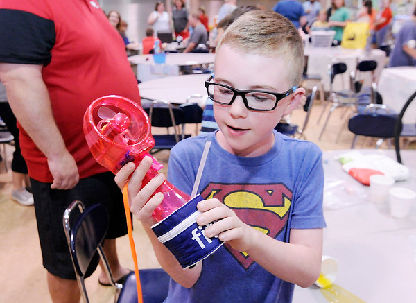 """Don Knight   The Herald Bulletin<br /> To fight the hot days of summer Carter Wachs created the """"Water Wizard"""" for the Invention Convention at Frankton Elementary on Tuesday. The misting fan is also a water bottle and has a pouch to hold your keys and other essentials."""