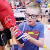 "Don Knight | The Herald Bulletin<br /> To fight the hot days of summer Carter Wachs created the ""Water Wizard"" for the Invention Convention at Frankton Elementary on Tuesday. The misting fan is also a water bottle and has a pouch to hold your keys and other essentials."