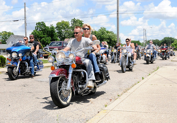 Don Knight   The Herald Bulletin<br /> Bikers leave Las Maria's for the Madison County Making a Stand Against Heroin Benefit Ride on Saturday. Proceeds from the ride were given to Vickie Horton to help cover her daughter Carissa's funeral expenses.