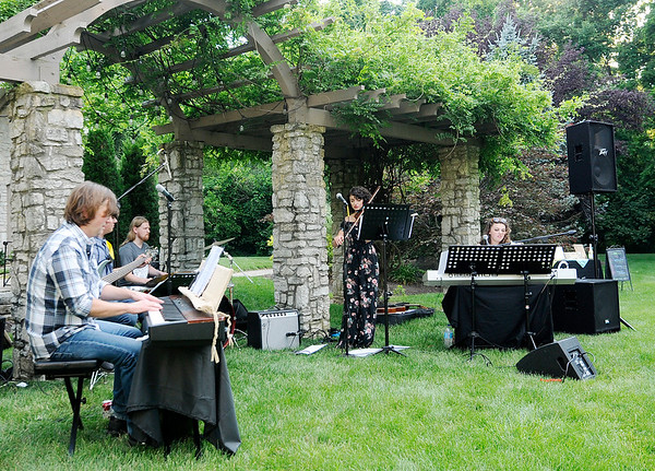 Don Knight   The Herald Bulletin<br /> The Campbell Jazz Continuum plays an outdoor concert to benefit the Anderson Symphony Orchestra at the home of Jan and Nancy Ricker on Thursday. From left are, Russ Campbell, Trey Campbell, Rick Singleton, Emma Campbell and Alyssa Campbell.