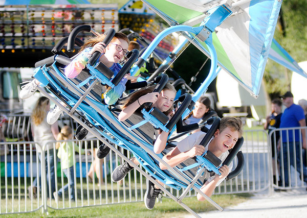 Don Knight | For The Herald Bulletin<br /> From left, Emma Romine, Rileigh Kartchner and Justin Delk ride the Hang Glider at the June Jamboree in Pendleton on Wednesday. The Jamboree runs through Saturday at Falls Park.
