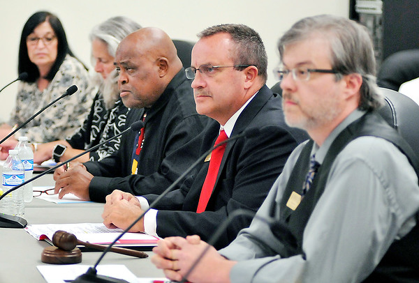 John P. Cleary |  The Herald Bulletin<br /> Newly appointed ACS interim superintendent Dr. Tim Smith, second from right, takes his seat among the elected board members after being named to the position.