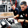 John P. Cleary |  The Herald Bulletin<br /> Anderson Fire Department B shift Medic1 EMT Matt Greenlee and paramedic Dillon Rivera go over their medical bag which includes Narcan that revives victims of drug overdoses and helps protect themselves while treating the victims if they become exposed.