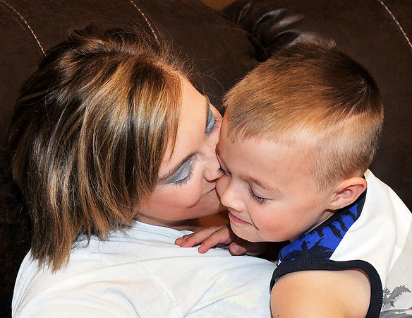 John P. Cleary |  The Herald Bulletin<br /> Natasha McAdams and her son Bentley Chesnut, 5, have a quiet moment together at home after Bentley was shot in the head with a high-powered air rifle several weeks ago.