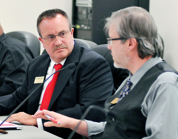 John P. Cleary |  The Herald Bulletin<br /> Newly appointed ACS interim superintendent Dr. Tim Smith confers with board president Pat Hill during Tuesday's meeting.