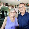 John P. Cleary |  The Herald Bulletin<br /> Barbara and Fred Freeman are retiring as foster parents after more then 50 years. Shown here in the childrens playroom, they are surrounded by more then 150 photographs of children they have fostered.