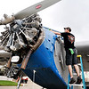 John P. Cleary |  The Herald Bulletin<br /> Jonathon Carver, of Anderson Aircraft Services, cleans the windows of the Ford Tri Motor aircraft Thursday in preparation for Aviation Days 2017 at the Anderson Municipal Airport Darlington Field this weekend. The public will be able to take a ride on the historic plane during the hours of 9 to 5 Friday, Saturday, and Sunday.