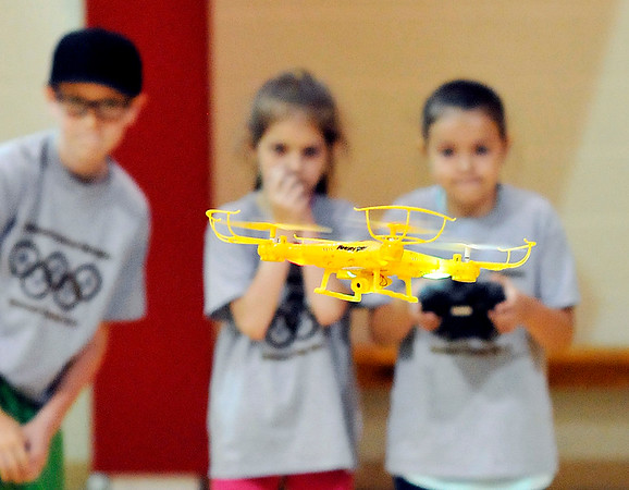 John P. Cleary    The Herald Bulletin<br /> Members of the Science Camp watch intently as one of them operates a quadcopter and tries to land it on a landing pad during one of the activities the kids experienced during the camp.