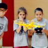 John P. Cleary |  The Herald Bulletin<br /> Members of the Science Camp watch intently as one of them operates a quadcopter and tries to land it on a landing pad during one of the activities the kids experienced during the camp.
