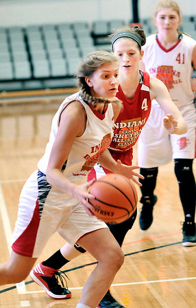 John P. Cleary    The Herald Bulletin <br /> Frankton's Sydney Tucker drives around her defender during play in the Junior Girls All-Star game Friday at AU.