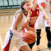 John P. Cleary |  The Herald Bulletin <br /> Frankton's Sydney Tucker drives around her defender during play in the Junior Girls All-Star game Friday at AU.