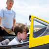 Don Knight   For The Herald Bulletin<br /> Liam Bowell, 10, gets a look inside the cockpit of a PT26A with the help of Dave Grollimund during Aviation Days at the Anderson Municipal Airport on Saturday.