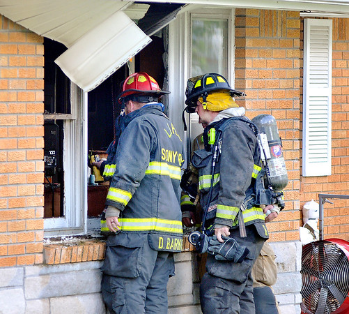 John P. Cleary |  The Herald Bulletin<br /> Firefighters from multiple departments battled a structure fire Monday afternoon in a duplex in the 1800 block of Park Road in Edgewood. No one was home at the time of the fire and no injuries were reported.