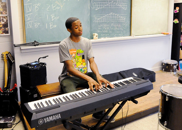Don Knight | The Herald Bulletin<br /> Austin Morgan teaches students about twelve-bar blues during the Summer Camp at the Anderson Township Trustee Youth Center.