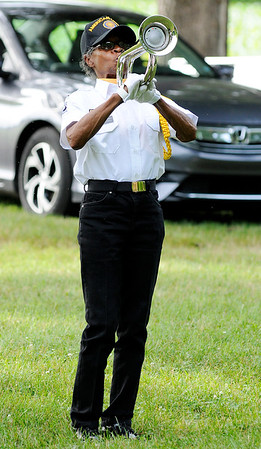 Don Knight   The Herald Bulletin<br /> Jacqueline Wingfield, a member of the Daleville Post 446 Honor Guard, uses a digital bugle to play Taps during a flag retirement ceremony. The ceremony is held annually on Flag Day.
