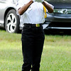 Don Knight | The Herald Bulletin<br /> Jacqueline Wingfield, a member of the Daleville Post 446 Honor Guard, uses a digital bugle to play Taps during a flag retirement ceremony. The ceremony is held annually on Flag Day.