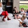 John P. Cleary | The Herald Bulletin <br /> These Elwood Intermediate summer school students react as the new Elwood Community Schools superintendent, Dr. Casey Smitherman, reads to them Monday.