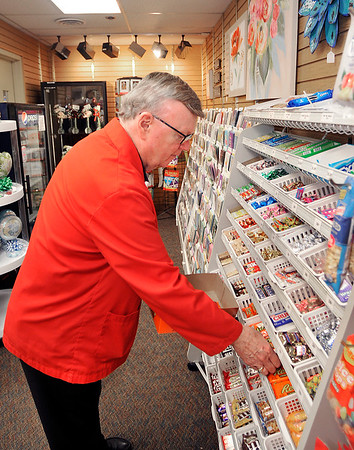 John P. Cleary   The Herald Bulletin<br /> Michael Litten is a St. Vincent Anderson volunteer that works in the Hospital's gift shop. Here Michael restocks the candy bins.