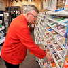 John P. Cleary | The Herald Bulletin<br /> Michael Litten is a St. Vincent Anderson volunteer that works in the Hospital's gift shop. Here Michael restocks the candy bins.