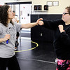 Don Knight | The Herald Bulletin<br /> From left, Deborah McManus and Liz Miller practice what they have learned about fighting back during active shooter training involving local officers and teachers at Daleville High School on Saturday.