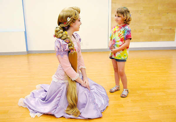 Don Knight | The Herald Bulletin<br /> CC Cox, 5, meets the Tower Princess from local company Once Upon A Princess as Anderson Public Library kicked off their Summer Reading Program with a carnival on Thursday. The program's goal for the summer is 1,000,000 minutes.