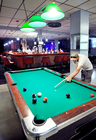 John P. Cleary | The Herald Bulletin <br /> James Campbell shoots some pool as he relaxes at the Fraternal Order of Eagles Lodge 174.